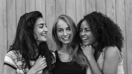 Three beautiful young women having fun outdoors